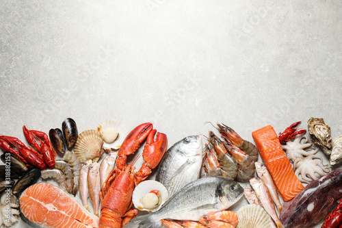 Fresh fish and seafood on marble table, flat lay. Space for text Fototapeta