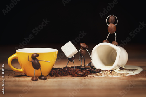 Fototapeta coffee bean figures with a cup of coffee and sugar cubes obraz