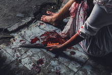 Horror Scence Of Women Hold Knife By Hands With Blood. Ghost Women Wear White Dress Stain Blood At Abandoned House