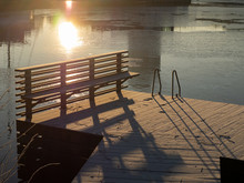 Snow Covered Pier With Suns Re...