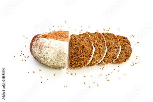 Fototapeta Sliced organic bread with flax seeds arranged isolated on a white background. obraz