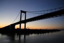 Pont D'Aquitaine Bridge At Sunset. It Is A Large Suspension Bridge Over The Garonne, North-west Of The City Of Bordeaux, France.