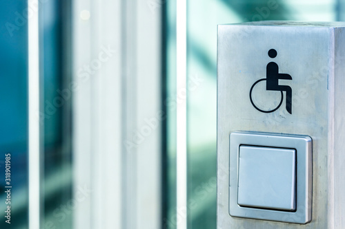 disabled sign and door opening button Wallpaper Mural