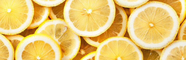 Sliced lemons. Background and texture. Panorama.