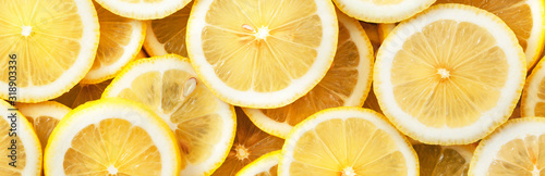Sliced lemons. Background and texture. Panorama.	 - 318903336