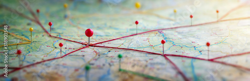 Obraz Find your way. Location marking with a pin on a map with routes. Adventure, discovery, navigation, communication, logistics, geography, transport and travel theme concept background. - fototapety do salonu