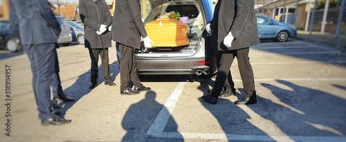 Fényképezés Gravediggers put coffin into car