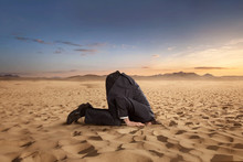 Desparate Businessman Hiding Head In The Sand At The Desert With Copy Space