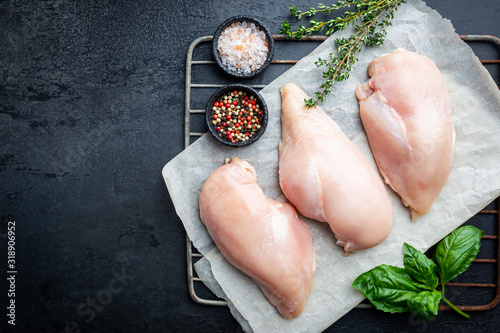 Fresh raw chicken breast with herbs and spices, top view Fototapete