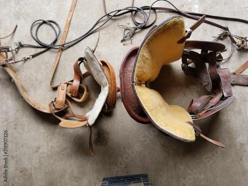 Obraz Saddles And Bridles On Floor - fototapety do salonu