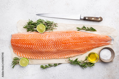 Fresh raw salmon or trout sea fish fillet with spices and herbs on white backgro Fotobehang