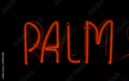 red palm neon sign isolated black background
