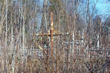 One Brown Rusty Iron Cross In ...