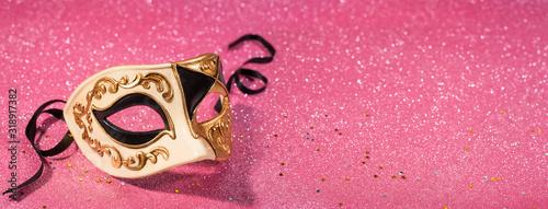 Fototapeta Venetian carnival mask with pink glitter background banner format obraz