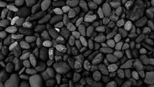 Black Pebble Beach Stone Backg...