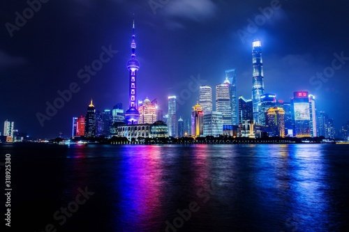 Fototapeta ILLUMINATED BUILDINGS IN CITY AT NIGHT obraz