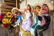 Close-Up Of Puppets Hanging For Sale