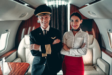 Pilot And Flight Attendant In Private Jet