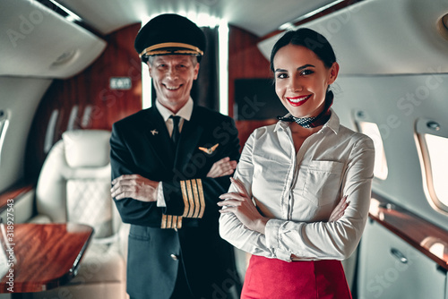 Pilot and flight attendant in private jet Canvas Print