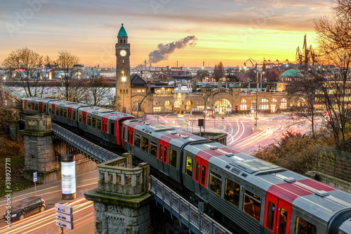 High Angle View Of Train On Railway Bridge In Illuminated City During Sunset - fototapety na wymiar