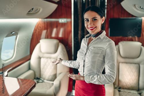 Stampa su Tela Flight attedant in private jet