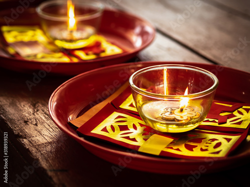 Candles in glass cups and joss papers Wallpaper Mural