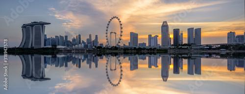 Fototapeta REFLECTION OF BUILDINGS IN LAKE AGAINST SKY DURING SUNSET obraz