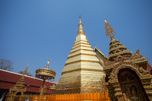 The Golden Pagoda At Wat Phra That Cho Hae In Phrae Province, Thailand.