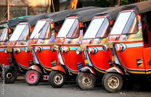 Vászonkép  Rickshaws Parked In Row On Street At City