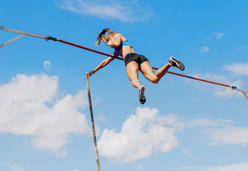 woman athlete pole vaulter successful attempt of competition in athletics