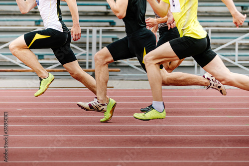 legs men athletes runners running race sprint in athletics Fototapete