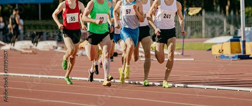 Fényképezés group male runners running middle distance race