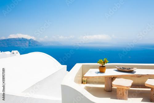 Fototapeta White architecture on Santorini island, Greece. Beautiful terrace with sea view. Travel destinations concept obraz