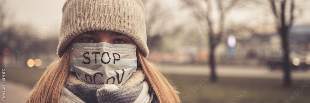 Fototapeta MERS-CoV Chinese infection Corona Virus masked girl on the background of the city in smog, the concept of the epidemic of the virus in China coronavirus nCov