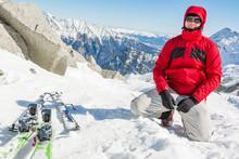Male Ski Tourer Posing Next To...