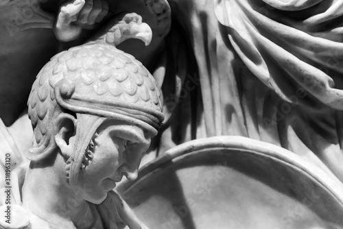 Foto Detail of soldier head of classical roman statue  - black and white photo