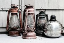 Vintage Lanterns On Table Against Wall