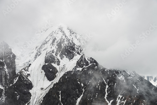 Fotografia, Obraz Atmospheric minimalist alpine landscape with massive hanging glacier on snowy mountain peak