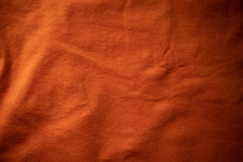 Orange Textile Background. Dar...