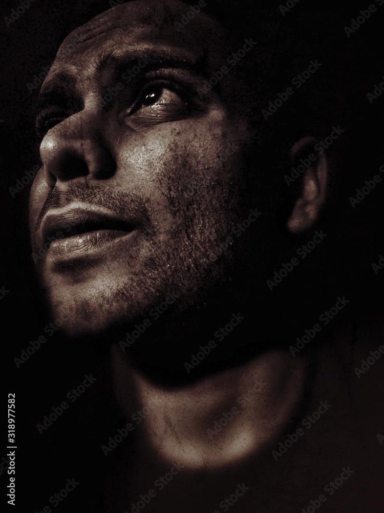 Fototapeta Close-Up Of Man Against Black Background