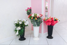 Three Vases With Different Types Of Flowers Are In The Store For Sale. Wedding Bouquets And Gifts For Newlyweds From Guests.