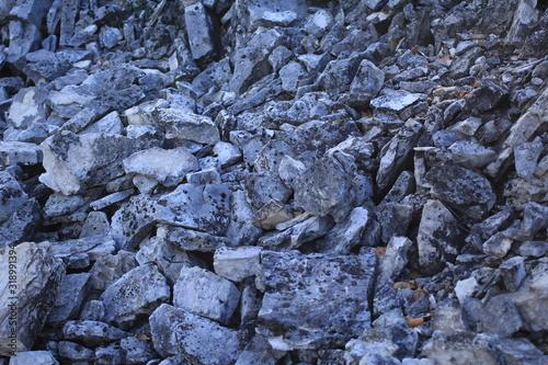 Obraz na plátně big gray rock stones dropped on ground. rockfall scene