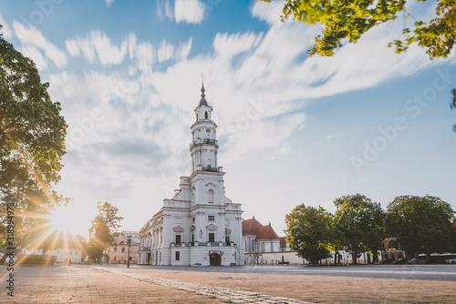 Fototapeta Church And Buildings Amidst Trees Against Cloudy Sky obraz
