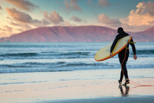 Lone Surfer Walks Into The Oce...