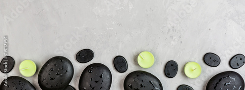 Top view of hot spa stones set for massage treatment on gray concrete background with copy space Wallpaper Mural