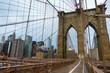 People walking in Brooklyn bridge at day time