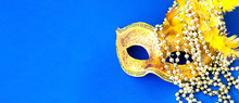 Carnival Mask On Blue Background With Silver Beads. Mardi Gras Concept. Copy Space