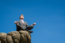 Businessman Seated In A Yoga P...