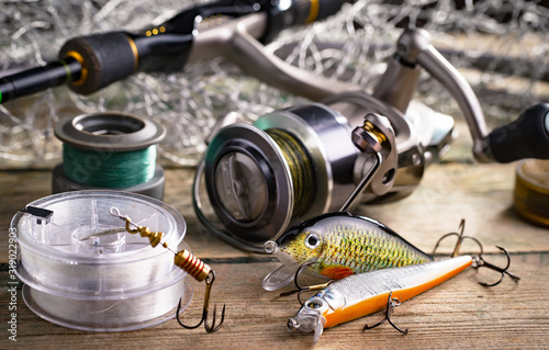 fishing tackle on a wooden table. toned image Tableau sur Toile