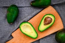 Avocado On A Chopping Wooden Board. Avocado, Vegetable, Food, Organic, Green, Vegetarian